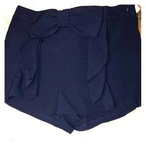 Super cute navy blue shorts with bow.